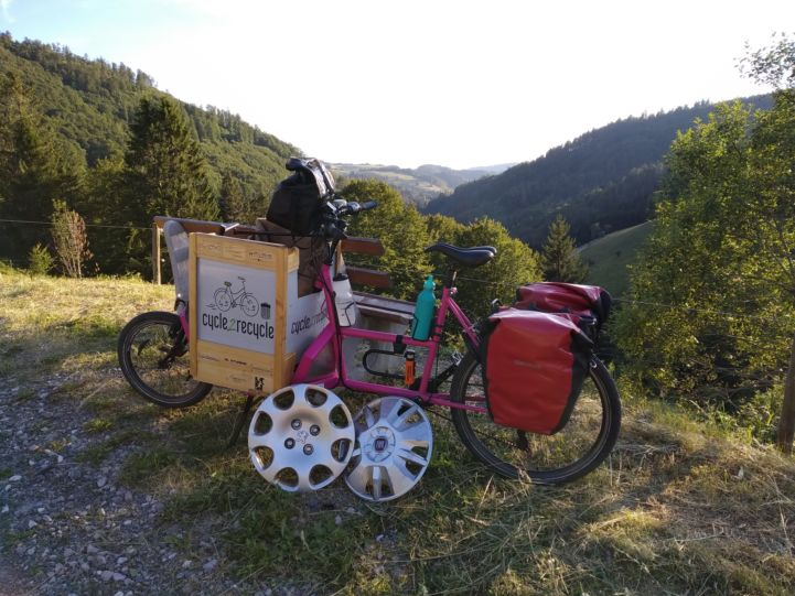 Cycling in the Black Forest with several big car parts.jpg